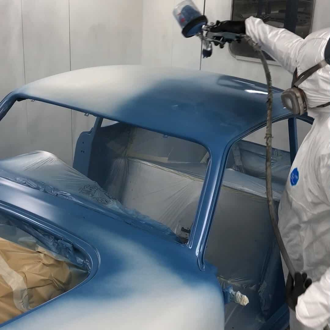 K7 paint, reconstituted and mixed with modern, more robust paint, being strayed over AC Bluebird