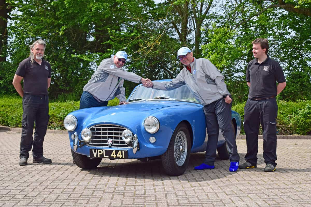 The AC Bluebird Mille Miglia Team Kevin and Duncan shaking hands