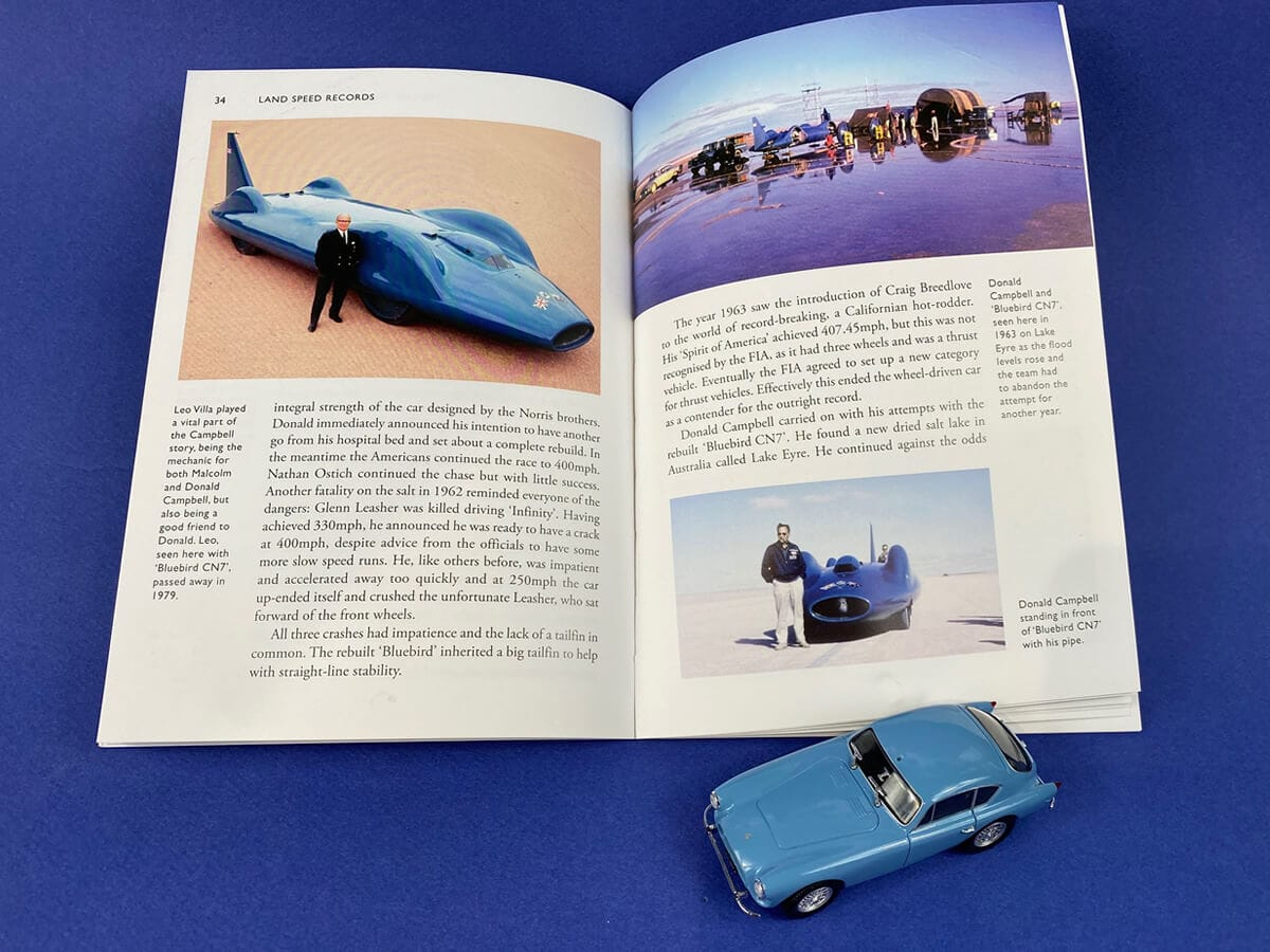 A photograph of the diminutive Leo Villa alongside Bluebird CN7, from Land Speed Records by Don Wales