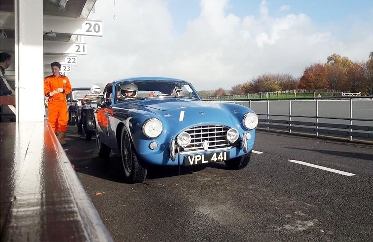 AC Bluebird in the pit lane, Goodwood circuit