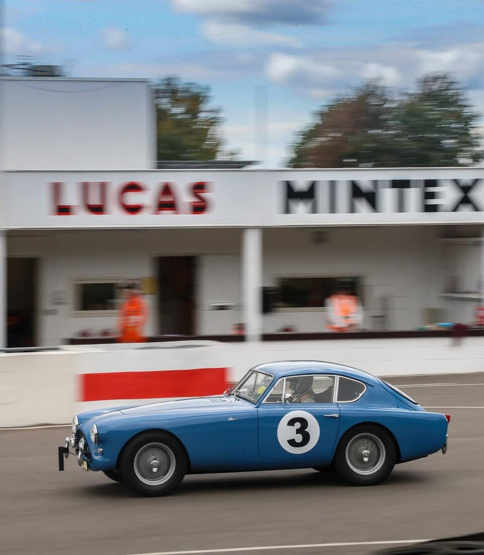 AC Bluebird accelerating hard past the pits at Goodwood 2021 ACOC Club Sprint