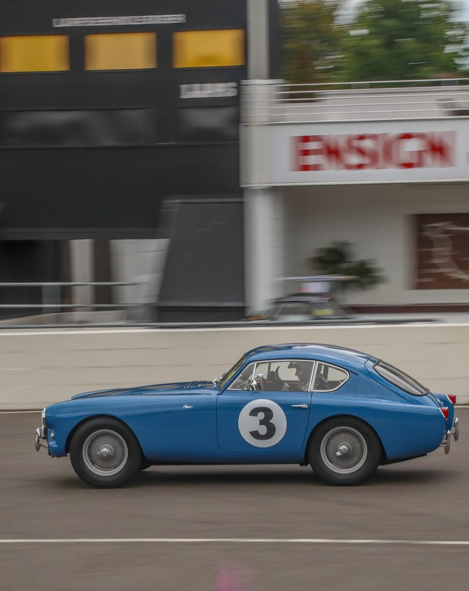 AC Bluebird passing the pits with thumbs-up from Kevin in the drivers seat at Goodwood 2021 ACOC Club Sprint